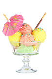 Multi flavor ice cream glass with umbrella Royalty Free Stock Image
