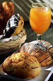 Multi Flavoured Bread And Orange Juice Stock Photos