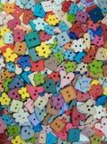 Multi forma e fondo variopinto dei bottoni Fotografie Stock