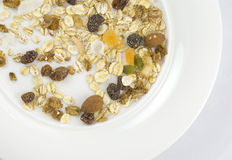 Multi fruit and nut muesli. Arranged on white plate isolated on white background Stock Photos