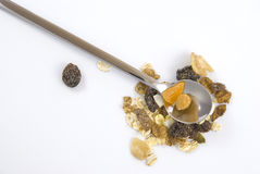 Multi fruit and nut muesli. With silver spoon isolated on white background Royalty Free Stock Images