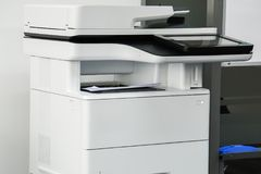 Multi-function printer machine ready for printing, copy, scanning business documents. In office royalty free stock image