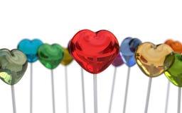 Multi gekleurde hartvorm lollypops stock fotografie