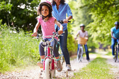 Multi Generation African American Family On Cycle Ride. Wearing Helmets Having Fun Stock Image