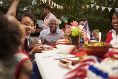 Multi generation black family at 4th July barbecue, close up Stock Photos
