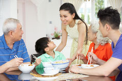 Multi-Generation Chinese Family Eating Meal. Portrait Of Multi-Generation Chinese Family Eating Meal Together Royalty Free Stock Image