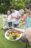 Multi-generation family at barbecue grille Stock Photography
