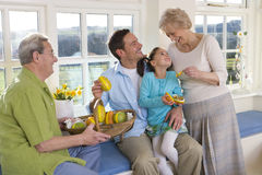 Multi-generation family with basket of wooden Easter eggs Royalty Free Stock Photography