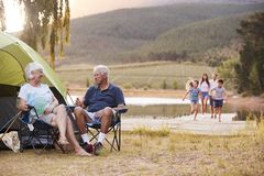 Multi Generation Family On Camping Trip By Lake Together royalty free stock photos