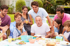 Multi Generation Family Celebrating Birthday In Garden Stock Photography