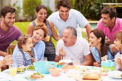 Multi Generation Family Celebrating Birthday In Garden Stock Images