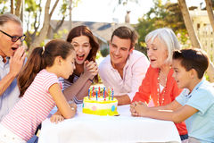 Multi-Generation Family Celebrating Birthday In Garden Stock Photos