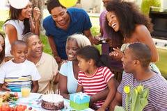 Multi Generation Family Celebrating Birthday In Garden Royalty Free Stock Image