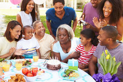 Multi Generation Family Celebrating Birthday In Garden Royalty Free Stock Photo