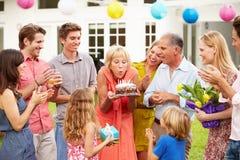 Multi Generation Family Celebrating Birthday In Garden Stock Photos