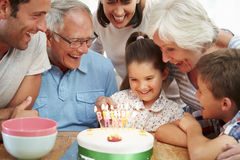 Multi Generation Family Celebrating Daughter's Birthday stock images