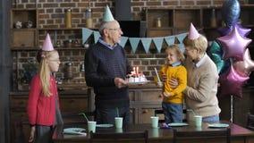 Grandparents singing happy birthday to grandson stock footage