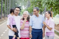 Multi generation family conversing on the road stock photography