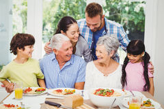 Multi generation family discussing at dining table Royalty Free Stock Photos