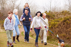 Multi Generation Family With Dog On Countryside Walk Stock Images