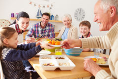 Multi Generation Family Eating Lunch At Kitchen Table royalty free stock photo