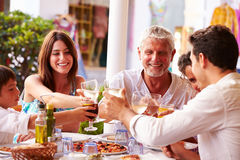 Multi Generation Family Eating Meal At Outdoor Restaurant stock image