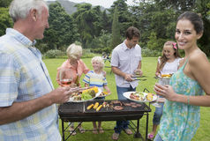 Multi-generation family enjoying barbecue and wine Royalty Free Stock Images