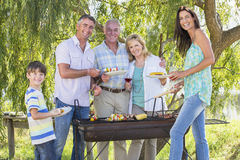 Multi-Generation Family Enjoying Barbeque By Lake Royalty Free Stock Photography
