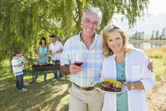 Multi-Generation Family Enjoying Barbeque By Lake Royalty Free Stock Images