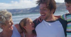 Multi generation family enjoying at beach stock video footage