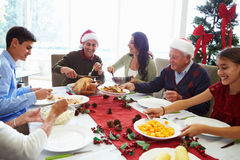 Multi Generation Family Enjoying Christmas Meal At Royalty Free Stock Images