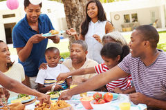 Multi Generation Family Enjoying Meal In Garden Together Royalty Free Stock Photo