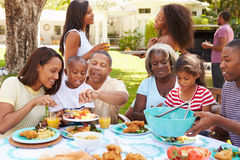 Free Multi Generation Family Enjoying Meal In Garden Together Royalty Free Stock Photography - 52853677