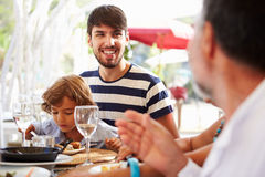 Multi Generation Family Enjoying Meal In Restaurant stock photos