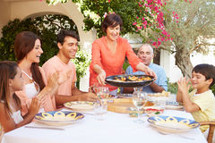 Multi Generation Family Enjoying Meal On Terrace Together Royalty Free Stock Image
