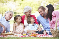 Multi Generation Family Enjoying Picnic Together Stock Photo