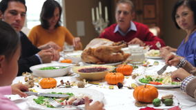 Multi Generation Family Enjoying Thanksgiving Meal Royalty Free Stock Images