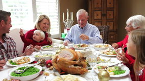 Multi Generation Family Enjoying Thanksgiving Meal Royalty Free Stock Image