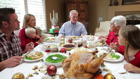 Multi Generation Family Enjoying Thanksgiving Meal Stock Photography