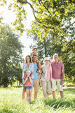 Multi-Generation Family Enjoying Walk In Beautiful Countryside Royalty Free Stock Image