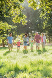 Multi-Generation Family Enjoying Walk In Beautiful Countryside Royalty Free Stock Photography