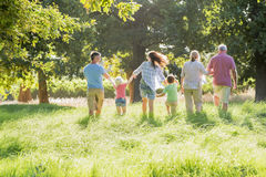 Multi-Generation Family Enjoying Walk In Beautiful Countryside Stock Images