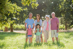 Multi-Generation Family Enjoying Walk In Beautiful Countryside Royalty Free Stock Photo