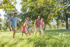 Multi-Generation Family Enjoying Walk In Beautiful Countryside Stock Image