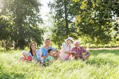 Multi-Generation Family Enjoying Walk In Beautiful Countryside Royalty Free Stock Images