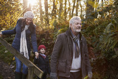 Multi Generation Family Enjoying Walk In Fall Landscape Royalty Free Stock Photos