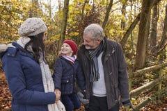 Multi Generation Family Enjoying Walk In Fall Landscape Stock Photos