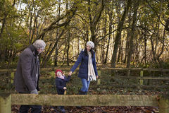 Multi Generation Family Enjoying Walk In Fall Landscape Royalty Free Stock Photography