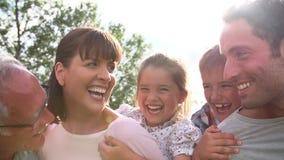 Multi Generation Family Giving Children Piggybacks Outdoors stock footage