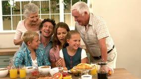 Multi generation family having breakfast stock video